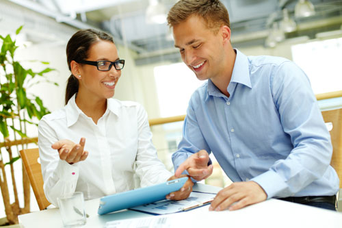 Man-and-woman-sharing-info-on-tablet-500.jpg